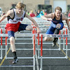 One two finish: South's Jeremy Patterson (L) clears the final hurdle enroute to a close victory over North's John Brainard. Brainard hit the final hurdle and lost by a small margin.