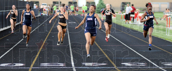 Runaway victory: North's Ashley Burkins wins the 100 by a wide margin during Tuesday's North/South track meet.