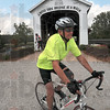 Tribune-Star/Joseph C. Garza<br /> Cycling through bridge country: Jym Littrell, director of the Lawrence County Habitat for Humanity, takes off from the Bridgeton Mill as he continues riding in the 2010 Cover Indiana Bicycle Tour Tuesday.