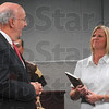 Tribune-Star/Joseph C. Garza<br /> So many families helped by her dedication: Timothy Morrison, United States attorney for the southern district of Indiana, congratulates Kathy Minger, executive director of the Vigo County crime assistance program, on her nine years of dedicated service after he presented her the United States Attorney's Carol S. Morris Award for Outstanding Contributions to the Rights of Victims Tuesday at the Vigo County Jail.