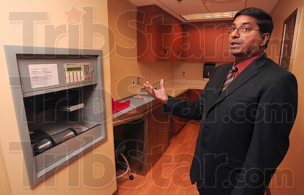 Tribune-Star/Joseph C. Garza<br /> A new state-of-the-art facility for cancer patients: Dr. Chandra Reddy explains how the processing center in the new state-of-the-art Paul Siebenmorgen Cancer Center at Terre Haute Regional Hospital will benefit the patients with the ability to get blood samples to the hospital's lab faster.