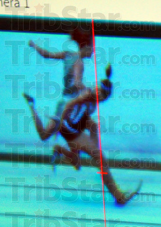 Photo finish: In an image taken from the official finish line camera, Patriot Tapring Goatee finishes just inches ahead of Shelby Higginbottom of North Central in the 800 meter run.
