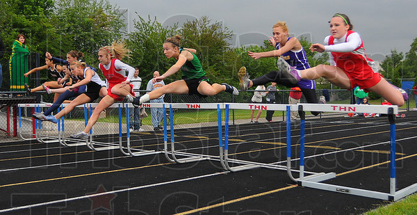 High hurdles: Lintons' Kelsi Andis, in lane 4, leads the runners over the first hurdle.