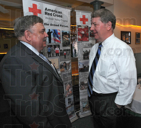 Annual meeting: Red Cross Board Chair Rod Beasley chats with Bob Baesler, Campaign Chair of the Save the Day Celebration before the Annual membership meeting Tuesday evening.