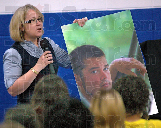 Mother's story: Patty Strole shows a photgraph of her son Travis who died in a one vehicle drunk driving accident during her presentation to students at McLean High School Tuesday morning.