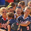 Enjoying success: Danielle Ketner is hugged by teammates after the Patriots' win over Martinsville Tuesday evening.<br /> THey includeBe5thany Sullivan(25) and Paige Collins(9).