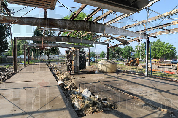 Skeleton: The former car wash located on the southeast corner of Hulman and Third Street is being removed along with other buildings on the lot as of Tuesday morning.