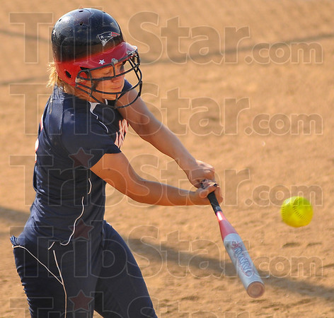 200x2=W: Danielle Ketner hits the tieing homerun against Martinsville Tuesday evening. One out later teammate Kelsey Coffey hit the go-ahead home run over the 195 foot mark of the Plainfield softball field.