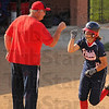 Bump: Patriot coach Jack Kirchner gives a fist bump to Kelsey Coffey as she rounds the bases after her homerun.