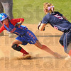 Rundown: Martinsville baserunner Megan Wilson stares wide-eyed at Danielle Ketner as Ketner applies in the tag in a rundown.