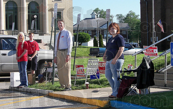 "Robert Alex ""Bob"" Pell, Republican candidate for Clay County prosecutor (center) and Hannah Yeiser, stepdaughter of Republican incumbent prosecutor B. Lee Reberger, greet voters Tuesday morning at the entrance to Brazil 1 Precinct in City Hall. Laura Smiley and Larry Knight (far left) were at the poll to encourage voters to re-elect Marcia Tozer, Brazil Township trustee, in the 2010 Primary."
