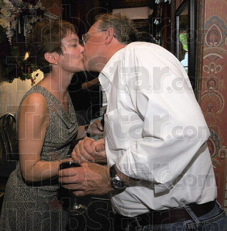 We did it: Bionca Gambill gets a congratulatory kiss from her husband Chris at their post election get togethher Tuesday night.