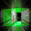 A neon green walkway to the virtual theater and hydrolically enhanced race car racing video whatcha-majig...