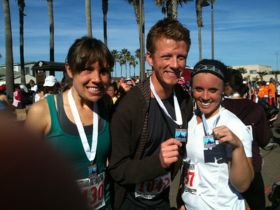 Bethany, Michael and Unknown Friend after finish of Half Marathon in under 2 hours.