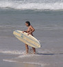Minne Waters, opposite shops, pretty girl enjoying the surf