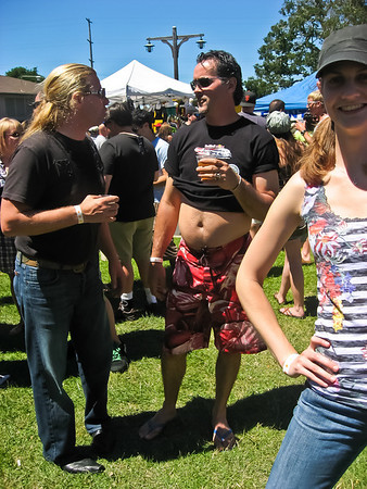 Lillian pretended to pose for a picture so I could get a shot of the beer bellied dude and the long haired dude. Gross!