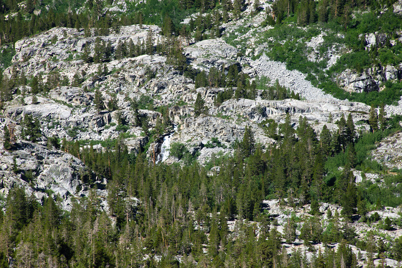 Different shades of green and gray, plus a waterfall above Lake Sabrina