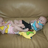 Elyse and Connor; Dina's twins play footsy...