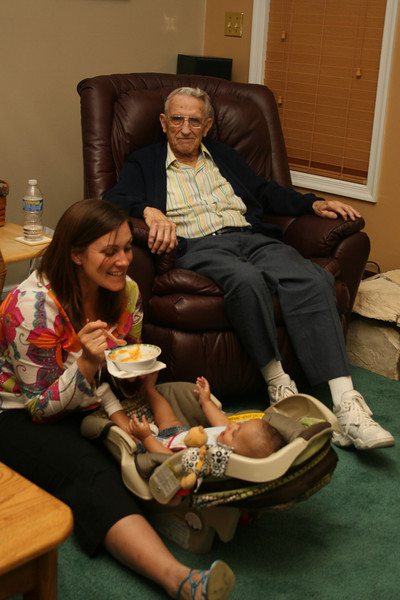 Katie feeds Marshall as Poppop looks on
