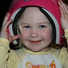 Ashleigh trying on Jenna's new tball helmet; backwards, of course!