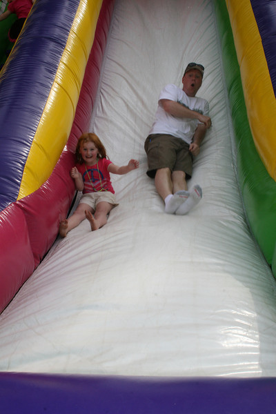 Mark takes a turn down the slide with Charlie