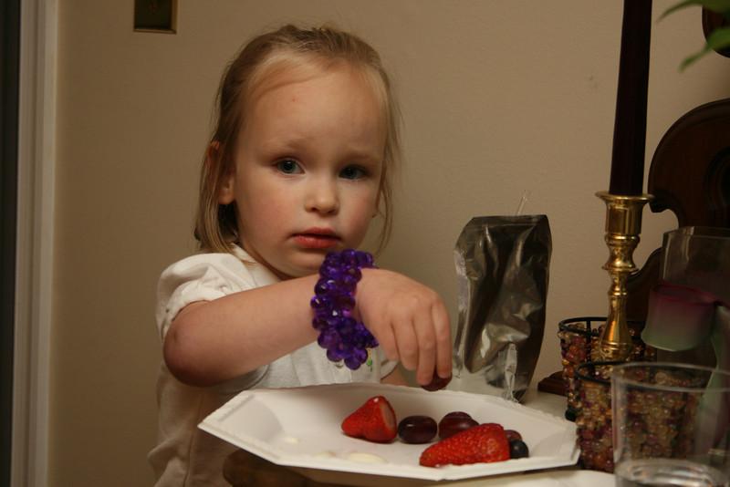 my cousin's daughter Emma enjoying the fruit