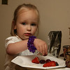 my cousin's daughter Emma enjoying the fruit
