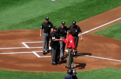 President Barack Obama greets the umpires
