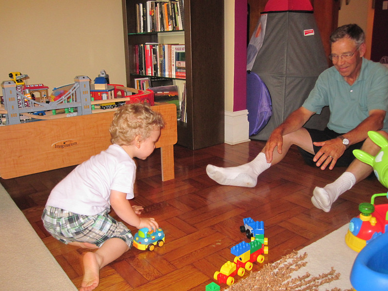 Doug (Grandpa) and Alex play on the floor