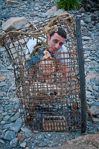 We went for a drive along the coast just outside of Newport and it really reminded me of the drive along CA-1 near Big Sur/Monterey. We pulled over at a beach, got out, and had some fun.   As we were leaving Steve found this neat old fishing cage and decided to pose as if he had been captured. Tasty!