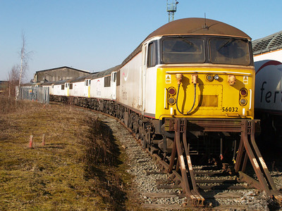 Stored 56032 heads a line of 56's at Crewe Diesel Depot.