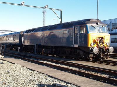 Arriva 57313 sits at Holyhead.