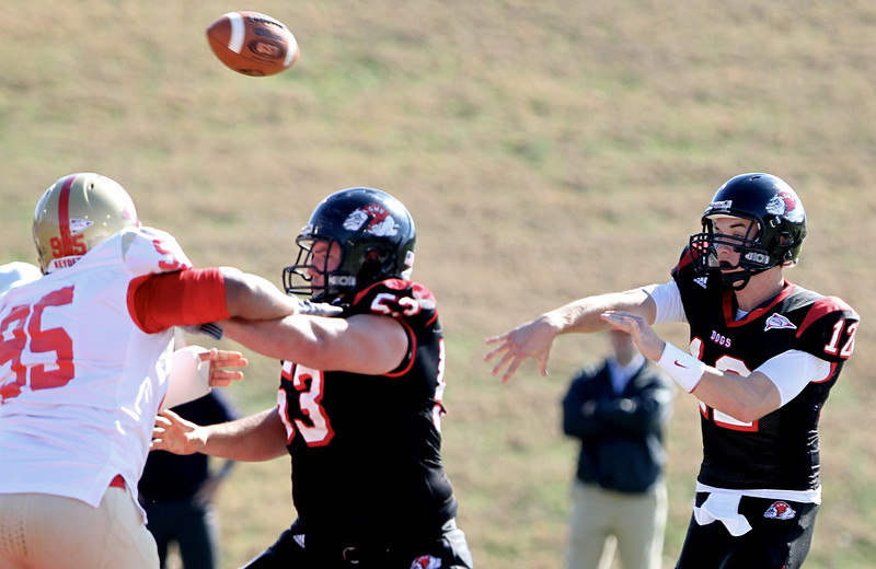 Gardner-Webb quarterback Chandler Browning (12) gets off a pass in the second quarter behind the blocking of Bulldog center C.J Bryant (53) in the Bulldogs 10-7 victory over VMI on November 20, 2010. Photo by Bob Carey
