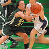 Close encounter: Viking guard Brooklyn Waters(11) pokes the ball away from Greencastle's Alyssa Nichols(3) early in their first round matchup in the Tip Off Tournament.