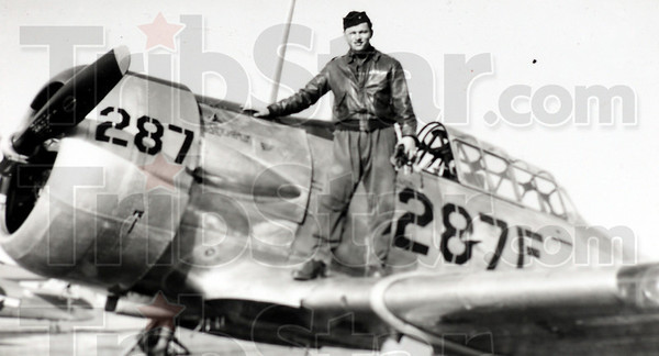 In training: Con Harrold stands on the wing of his HE-6 trainer during his time in flight school.