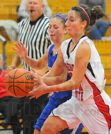 Contact: Rox Jenifer Lee reaches in to stop Terre Haute South's Kaylee Ellis from a layup in second half action Thursday night.