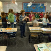 On their toes: Norma Williams drills her 4th graders on action versus non action verbs at the end of their school day.