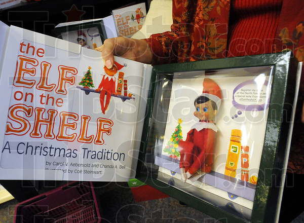 "Elf on the Shelf: Hallmark store owner Susan McCallum shows one of the items that will be ""hot"" for Christmas this year."
