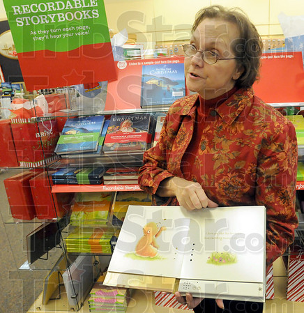 Grandma's voice: Susan McCallum talks about the recordable storybooks in her Plaza North Hallmark store that will have an additional discount for Black Friday.
