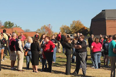 Faculty, staff and students wait for the groundbreaking ceremony for the new Tucker Student Center on the edge of Lake Hollifield.
