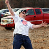 Style: Aaron Burris demonstrates his record setting form. He successfully threw the corn-filled bag 106 feet into the target for the mark.