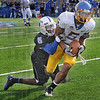 Hauled down: Sycamore Calvin Burnett was recognized for 2 MVFC honors, Newcomer and Defensive Player of the Week. Here he stops SDSU wide receiverAaron Rollin.