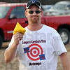 New record: Aaron Burris displays a cornhole bag and his t-shirt. He set a new record, 106 feet, over 4 times the regulation distance for the game.