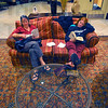 Down time: Margie James, mother of Northern Arizona University cross country runner Eric Lynch and Amy Hafer, his girlfriend, read books in the lobby of the Hilton Garden Inn while Lynch was in a team meeting upstairs.