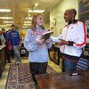 "Author, author: Cassidy Hass talks with Meb Keflezighi at teh Boob Nation bookstore Sunday afternoon. MArathon champion Keflezighi was signing copies of his book ""Run to Overcome""."