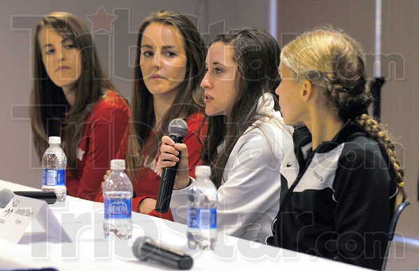 Meet the press: Twin sisters Holly and Lucy Van Dalen, New Zealanders who run for Stony Brook, listen to Villanova standout Sheila Reid as she answers a question during Sunday's press conference. On the right is Oregon runnerJordan Hasey.