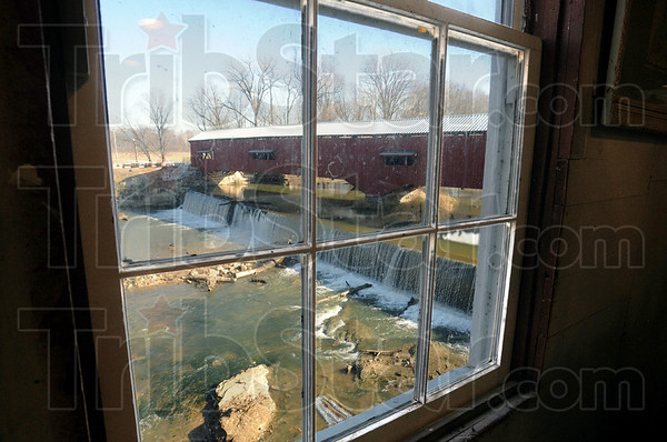Best view in town: The view of the Bridgeton covered bridge is provided by looking out the window of the Bridgeto Mill Sunday afternoon.