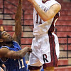 Elbow: Rose-Hulman's #11, Jason Hasiag gets tapped on the elbow just enough to throw off the shot during game action against Millikin Sunday afternoon.