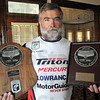 Qualified: Dave Watson of Sullivan holds two of his event trophies Sunday afternoon. Dave has qualifed for the 2011 Bassmaster's Tournament.