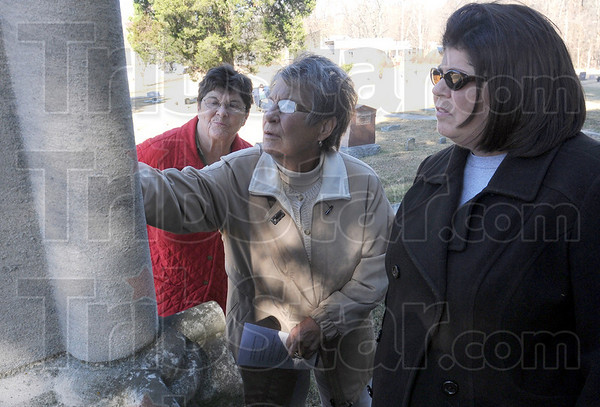 Walkers: Florence Roehm (L), Mary Jane Willoughby and Laurie Ifert look at names on a tombstone as they take the Historic Cemetery Walk Sunday afternoon in St. Mary's Village.
